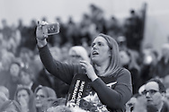 "Westbury, New York, USA. January 15, 2017.  Administrator of Together We Will Long Island, TWWLI, is recording a speaker at the ""Our First Stand"" Rally against Republicans repealing the Affordable Care Act, ACA, taking millions of people off health insurance, making massive cuts to Medicaid, and defunding Palnned Parenthood. Hosts were Reps. Kathleen Rice (Democrat - 4th Congressional District) and Thomas Suozzi (Dem. - 3rd Congress. Dist.). It was one of dozens of nationwide Bernie Sanders' rallies for health care that Sunday."