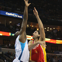 Jan 02, 2010; New Orleans, LA, USA; Houston Rockets forward Luis Scola (4) shoots over New Orleans Hornets center Emeka Okafor (50) during the first quarter at the New Orleans Arena. Mandatory Credit: Derick E. Hingle-US PRESSWIRE
