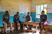 The team of volunteers prepare for their school training session with pupils as part of the ICS Raleigh SWASH (school water, sanitation and hygiene plan) project. Mbulu, Manyara district, Tanzania. Working in partnership with the Diocese of Mbulu Development Department (DMDD); part of Caritas Tanzania.
