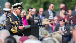© Licensed to London News Pictures. 06/06/2014. Bayeux, Normandy.  Prince Charles delivers a reading during the memorial service at the British military cemetery in Bayeux.  The service was part of a day of events marking the 70th Anniversary D Day.  Also in attendance were HRH The Queen and Prince Phillip, Prince Charles and various British political figures.  Photo credit : Alison Baskerville/LNP