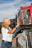 Senior woman checking her rural mailbox