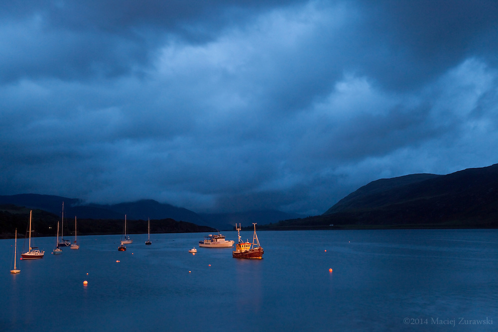 Late night view of boats on Loch Broom, seen from Ullapool, Scotland.