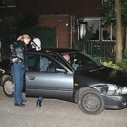 Auto in tuin Leeuwebek Huizen, na aanrijding door dronken bestuurder