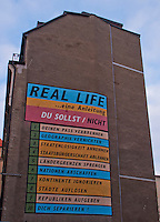 """Real Life"" - street art on the side of a building in Leipzig, Germany."