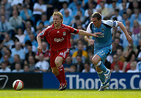 Photo: Jed Wee/Sportsbeat Images.<br /> Manchester City v Liverpool. The Barclays Premiership. 14/04/2007.<br /> <br /> Liverpool's Dirk Kuyt (L) keeps Manchester City's Richard Dunne away from the ball.