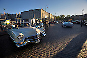During summer from June to Septemper, every first Friday of the month is Vintage Car Cruising Night. Hundreds of classic American cars cruise around downtown Helsinki and meet at special places to have a good time, here at Kauppatori (Market Square). 1956 (l.) and 53 Cadillac Convertibles.