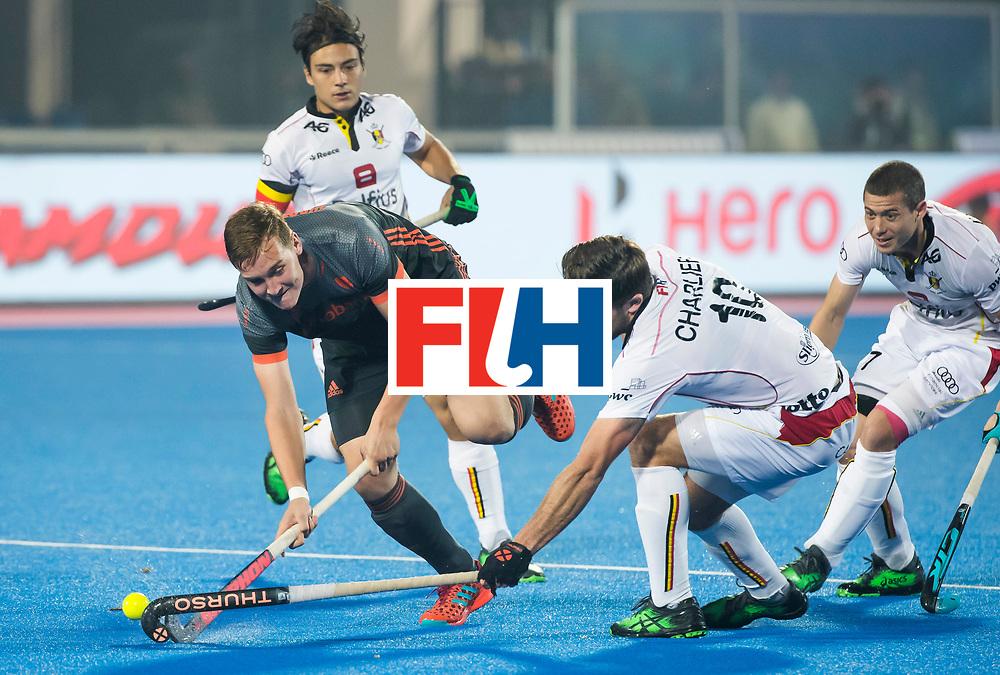 BHUBANESWAR - Floris Wortelboer (Ned) in duel met Cedric Charlier (Bel)  tijdens de Hockey World League Final wedstrijd Belgie-Nederland. rechts John-John Dohmen (Bel)  COPYRIGHT KOEN SUYK