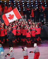 February 9, 2018 - PyeongChang, , South Korea - The Canada team marches in, led by flag bearer TESSA VIRTUE during the Opening Ceremony for the 2018 Pyeongchang Winter Olympic Games, held at PyeongChang Olympic Stadium. (Credit Image: © Scott Mc Kiernan via ZUMA Wire)
