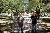 "PERDASDEFOGU, SARDINIA, ITALY - 30 JUNE 2013: (L-R) Stefano Lai, 27, and his cousing Alberto Lai, 19, walk in a park the day of their grandmother Claudina Melis' 100th birthday in Perdasdefogu, Italy, on June 30th 2013. Stefano Lai is now doing a post-doctoral fellowship in biomedical engineering at the prestigious Scuola Sant'Anna in Pisa. He would like to stay in Sardinia, or even in Italy, but doesn't have his hopes up. Alberto Lai lives and studies in Perdasdefogu.<br /> <br /> Last year, the Melis family entered the Guinness Book of World Records for having the highest combined age of any nine living siblings on earth — today more than 825 years. The youngest sibling, Mafalda – the ""little one"" – is 79 years old.<br /> <br /> The Melis siblings were all born in Perdasdefogu to Francesco Melis and Eleonora Mameli, who had a general store. Consolata, 106, is the oldest, then Claudia, 100; Maria, 98; Antonino, 94; Concetta, 92; Adolfo, 90; Vitalio, 87; Fida Vitalia, 81; and Mafalda, the baby at 79. Their descendants now account for about a third of the village."