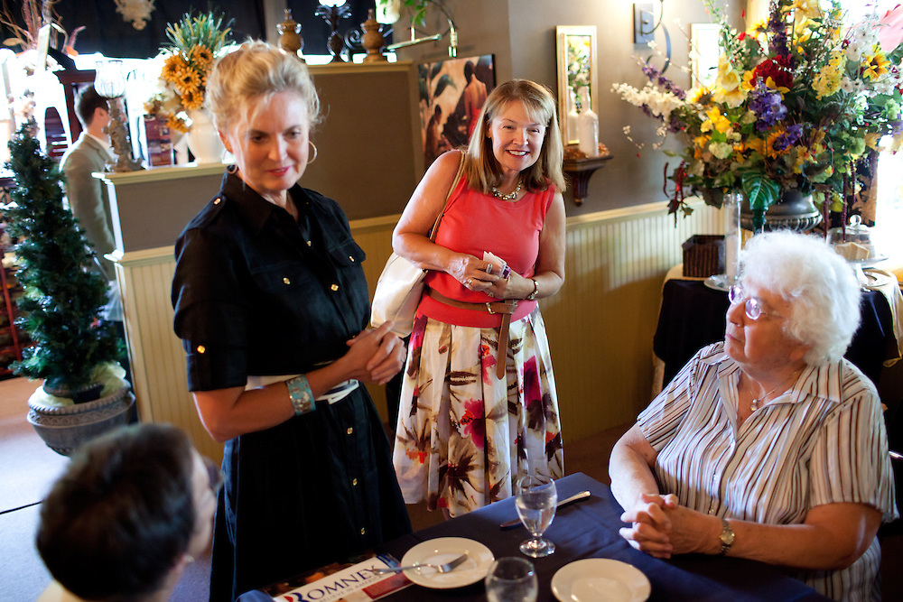 Political aide Susan Duprey (R) stands along side Ann Romney, the wife of Mitt Romney, at a campaign event at  Michele's Ristorante in Keene, NH on August 11, 2011.  (Matthew Cavanaugh for The Boston Globe)
