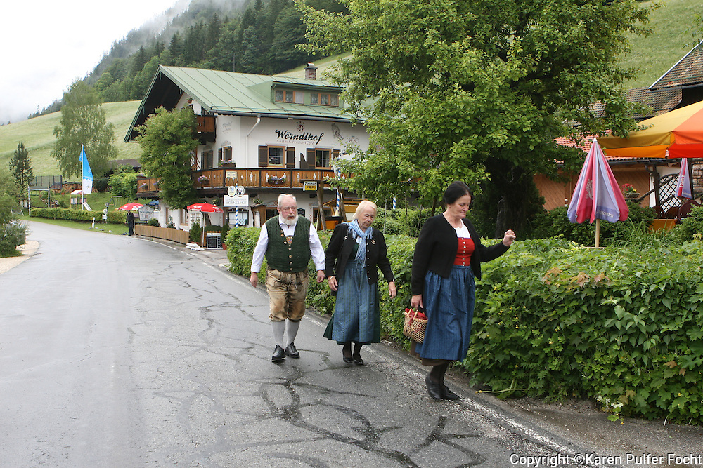 Germans walk in front of the Alpenhof Guesthouse ,  in Hintersee, Bavaria, Germany. The guest house was once visited by Adolph Hitler. It was also Hitlers Headquarters at the end of the war. All the Hitlers generals that were at the Berghof, moved in here at the very end of the war. It is near the Austrian border. It is situated in the heart of the Bavarian Alps.