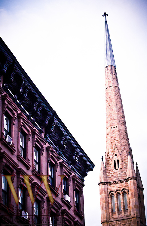 Brownstone and church skyline.