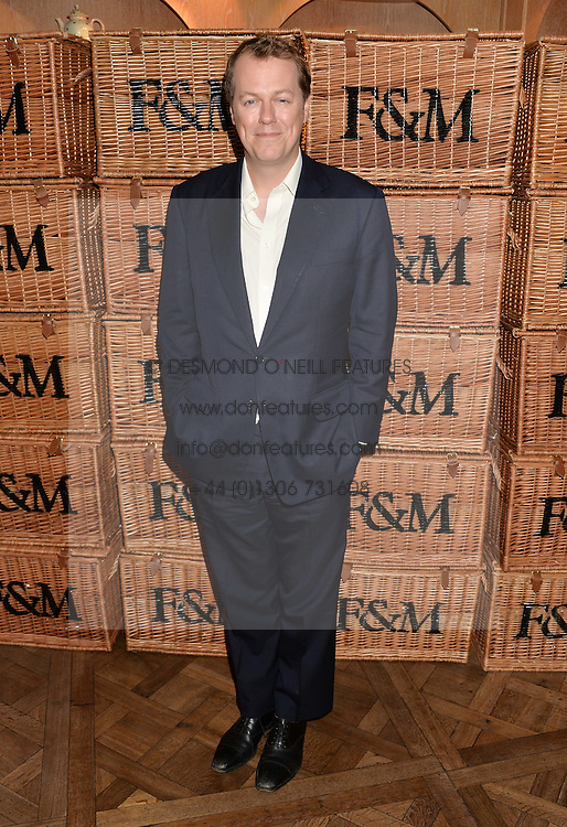 TOM PARKER BOWLES at a party to celebrate the publication of 'Let's Eat meat' by Tom Parker Bowles held at Fortnum & Mason, Piccadilly, London on 21st October 2014.