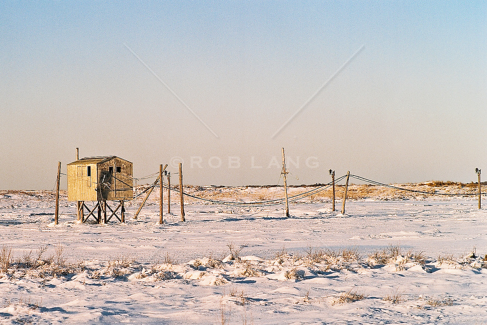 Built structure on snow-covered landscape