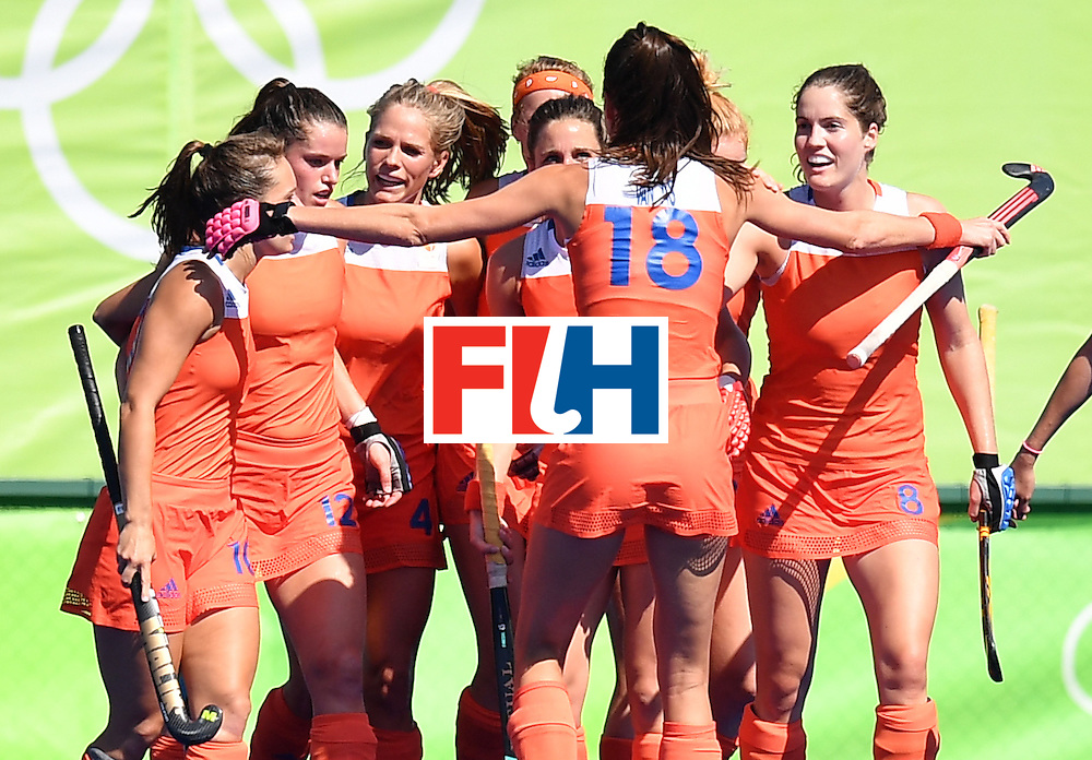 Netherlands' players celebrate scoring during the women's field hockey Netherlands vs Germany match of the Rio 2016 Olympics Games at the Olympic Hockey Centre in Rio de Janeiro on August, 13 2016. / AFP / MANAN VATSYAYANA        (Photo credit should read MANAN VATSYAYANA/AFP/Getty Images)