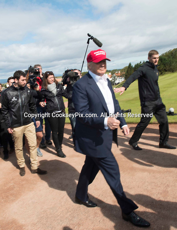 Picture by Christian Cooksey/CookseyPix.com . Standard repro rate apply.<br /> <br /> American Billionaire and Republican Presdential hopeful Donald Trump arrives at Trump Turnberry in Ayrshire, Scotland and talks to the press.<br /> He has arrived on the opening day of the Ricoh Women's British Open being held at Trump Turnberry.