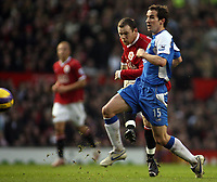 Photo: Paul Thomas.<br />Manchester United v Wigan Athletic. The Barclays Premiership. 26/12/2006.<br /><br />Wayne Rooney (L) of Man Utd shoots past Leighton Baines.
