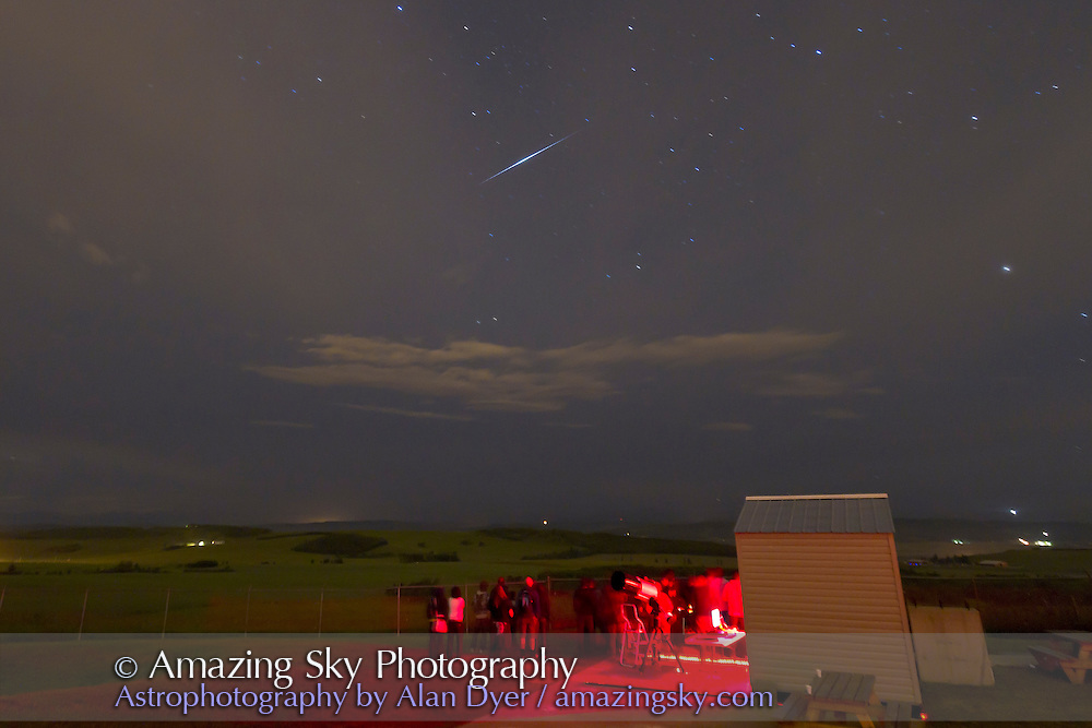 A bright -7 mag Iridium flare seen at Rothney Observatory, August 10, 2010, during annual Milky Way Night public observing session. This is a 1m10s exposure at ISO 1000 with 10-22mm lens at 12mm and f/3.5 with Canon 7D. Time of flare was 12:20 am on Aug 11. Exposure started as satellite appeared. Image cropped from original.