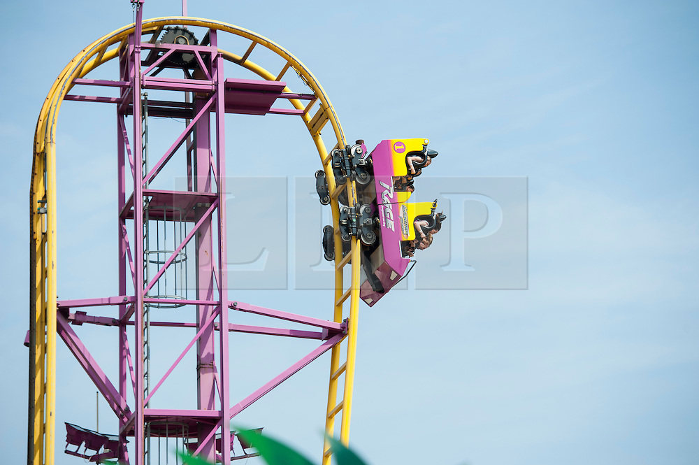(c) Licensed to London News Pictures. 05/05/2014. Essex, UK. May Day Bank Holiday at traditional resort, Southend on Sea. Some come for thrills and spills at the amusement park. Photo credit Simon Ford/LNP