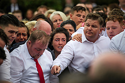 © Licensed to London News Pictures. 26/10/2017. Epsom, UK. Family members and mourners at the graveside at the funeral of Tom 'Tomboy' Doherty the nephew of Big Fat Gypsy Weddings star Paddy Doherty, at Epsom Cemetery in Epsom, Surrey. Tom Doherty was 17 when he was killed in a car crash in South Nutfield in Surrey on October 9. He had passed his driving test just days earlier. Photo credit: Ben Cawthra/LNP