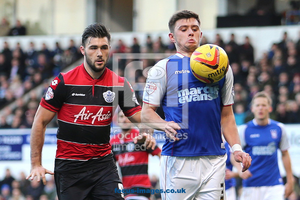 Picture by Richard Calver/Focus Images Ltd +447792 981244<br /> 11/01/2014<br /> Aaron Cresswell of Ipswich Town shields the ball from Charlie Austin of Queens Park Rangers during the Sky Bet Championship match at Portman Road, Ipswich.