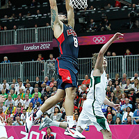 04 August 2012: USA Deron Williams dunks the ball during 99-94 Team USA victory over Team Lithuania, during the men's basketball preliminary, at the Basketball Arena, in London, Great Britain.