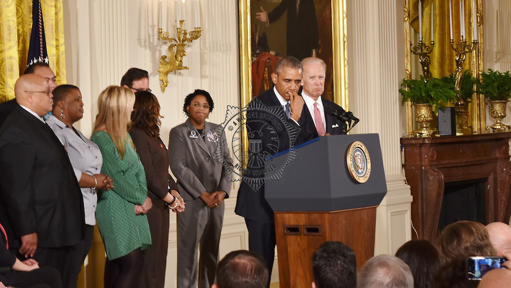 President Barack Obama flanked by Vice Presdent Joe Biden and families of victims(such as Nathanial and Cleopatra Pendleton-Crowley  at East Room at White House for Executive Action on #gunviolence. Obama was in tears and had glistening cheeks in some parts of the talk Cleopatra Cowley-Pendleton, Mother of Hadiya Pendleton who was killed a week after performing at the President&rsquo;s second inauguration, Nathaniel Pendleton, Sr., Father of Hadiya Pendleton, Jennifer Pinckney, Wife of Reverend Clementa Pinckney who was killed in the 2015 Charleston church shooting<br />    Peter Read, Retired Air Force Lieutenant Colonel and father of Mary Read who was killed in the 2007 Virginia Tech shooting<br /> <br /> <br /> &middot;      Emily Landers, Victim of a robber&rsquo;s bullet that left her partially paralyzed at the age of 21 and member of MoveOn&rsquo;s &ldquo;Gun Owners for Gun Control&rdquo;<br /> <br /> <br /> &middot;      David Taylor, Retired Army Officer and member of MoveOn&rsquo;s &ldquo;Gun Owners for Gun Control&rdquo;<br /> <br /> <br /> &middot;      Richard Martinez, Senior Research Associate for Everytown for Gun Safety and father of Christopher Michael-Martinez who was killed in the 2014 Isla Vista killings<br /> <br /> <br /> &middot;      Mandeep Kaur, Survivor of the 2012 Wisconsin Sikh temple shooting<br /> <br /> <br /> &middot;      Lucy McBath, National Spokesperson for Moms Demand Action for Gun Sense in America and mother of Jordan Davis who was killed while sitting in the back seat of a car in November 2013<br /> <br /> <br /> &middot;      Carolyn Tuft, Gun violence prevention advocate and mother of Kristin Hinckley who was killed in the 2007 Trolley Square shooting<br /> <br /> <br /> &middot;      Jennifer Longdon, Victim of a November 2004 shooting at a drive-thru<br /> <br /> <br /> &middot;      Jimmy Greene, Father of Ana Grace who was killed in the 2012 Sandy Hook Elementary School shooting<br /> <br /> <br /> &middot;      Daniel 