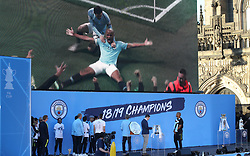 Manchester City's Vincent Kompany watches his goal of the season onstage during the trophy parade in Manchester.