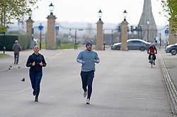 ©Licensed to London News Pictures 31/03/2020  <br /> Greenwich, UK. Runners in a quiet park. People get out of the house from Coronavirus lockdown to exercise in Greenwich Park, London. The Prime Minister Boris Johnson has asked people to stay at home to help in the fight against Covid-19 and to only go out for essential reasons. credit:Grant Falvey/LNP