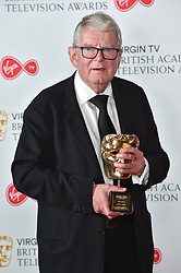 John Motson with his special BAFTA Award at the Virgin TV British Academy Television Awards 2018 held at the Royal Festival Hall, Southbank Centre, London.