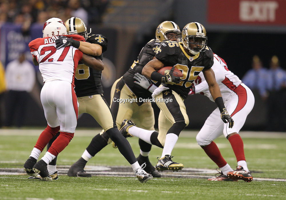 16 January 2010: New Orleans Saints running back Reggie Bush (25) breaks away for a touchdown run during a 45-14 win by the New Orleans Saints over the Arizona Cardinals in a 2010 NFC Divisional Playoff game at the Louisiana Superdome in New Orleans, Louisiana.