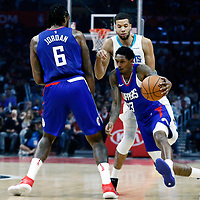 31 December 2017: LA Clippers guard Lou Williams (23) drives past Charlotte Hornets guard Michael Carter-Williams (10) on a screen set by LA Clippers center DeAndre Jordan (6) during the LA Clippers 106-98 victory over the Charlotte Hornets, at the Staples Center, Los Angeles, California, USA.