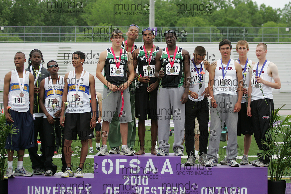 (London, Ontario}---05 June 2010) \Birchmount Park, W. F. Herman and Michael Power\ receive their medals at the 2010 OFSAA Ontario High School Track and Field Championships in London, Ontario,  June 05, 2010. Photograph copyright Julie Robins / Mundo Sport Images, 2010.
