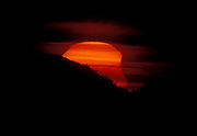 The Moon is eating the Sun. Sunrise partiell solar eclipse 3. May 2003 as seen from Langelandsfjellet, Hidra, South-western Norway.