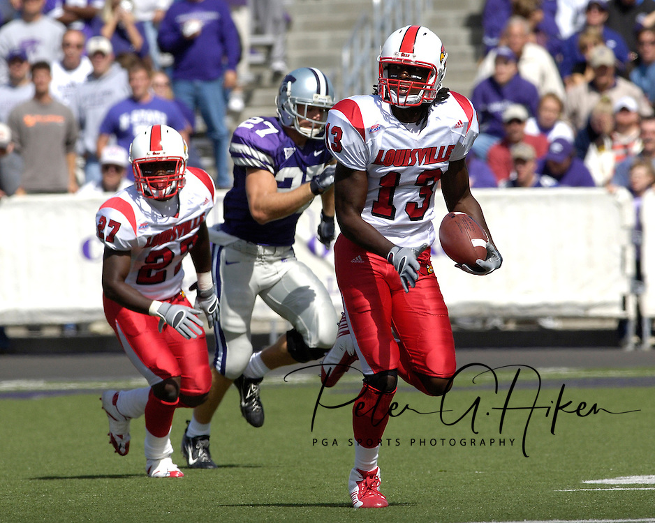 Louisville safety Jon Russell (13) rushes up field after intercepting a Kansas State pass in the first half at Bill Snyder Family Stadium in Manhattan, Kansas, September 23, 2006.  The 8th ranked Louisville Cardinals beat K-State 24-6.