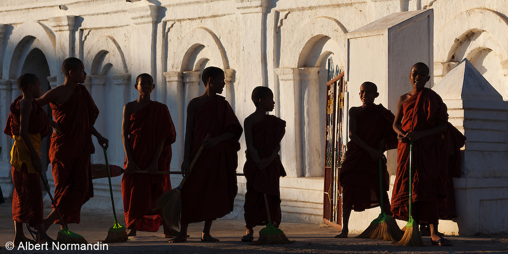 7 young Monk resting in front of Shwe Yan Pyay Monastery from their sweeping duties