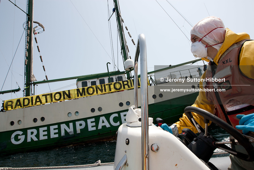 Crew from the Greenpeace ship Rainbow Warrior, including radiation safety advisor Jacob Namminga, collect sea water and seaweed samples to monitor for radiation contamination levels. As the Greenpeace ship sails up the eastern coast of Japan, in the vicinity of Fukushima, in Japan, Wednesday 4th May 2011..Tuomas Heikkila of FInland, driving the inflatable....Crew from the Greenpeace ship Rainbow Warrior, including radiation safety advisor Jacob Namminga, collect sea water and seaweed samples to monitor for radiation contamination levels. As the Greenpeace ship sails up the eastern coast of Japan, in the vicinity of Fukushima, in Japan, Wednesday 4th May 2011..At coordinates 36' 45.447 North, 141' 13.060 East.