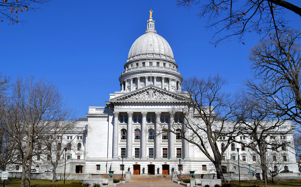 Wisconsin State Capitol Building in Madison, Wisconsin<br /> The Wisconsin State Capitol&rsquo;s dome is the largest by volume in the U.S. The pinnacle rises 284 feet. This is only 3 &frac12; feet shy of the U.S. Capitol. The building was constructed from White Bethel Vermont granite and completed in 1917. The symmetry of its four, 187 foot long wings gives it a nearly consistent appearance from any direction. They are equally beautiful. Wisconsin became the 30th state on May 29, 1848.