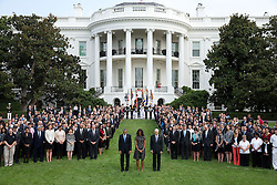 President Barack Obama, First Lady Michelle Obama and Vice President Joe Biden join White House staff on the South Lawn of the White House to observe a moment of silence marking the 13th anniversary of the 9/11 attacks, Sept. 11, 2014. (Official White House Photo by Chuck Kennedy)<br /> <br /> This official White House photograph is being made available only for publication by news organizations and/or for personal use printing by the subject(s) of the photograph. The photograph may not be manipulated in any way and may not be used in commercial or political materials, advertisements, emails, products, promotions that in any way suggests approval or endorsement of the President, the First Family, or the White House.
