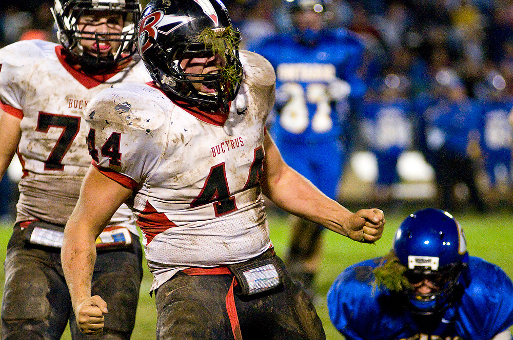 Bucyrus linebacker Jordan Teynor (44) celebrates after sacking Ontario quarterback Eric Wendling (14) in Ontario on Friday. The Redmen defeated the Warriors 21-8.