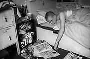 Neville Reading in Bed, Hawthorne Road, High Wycombe, UK, 1980s.