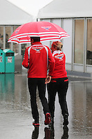 Jules Bianchi (FRA) Marussia F1 Team and Tracy Novak (GBR) Marussia F1 Team PR & Communications Director in a wet and rainy paddock.<br /> Japanese Grand Prix, Thursday 2nd October 2014. Suzuka, Japan.