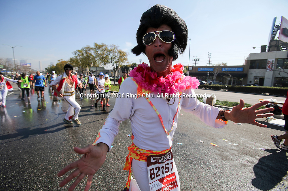 Runners make their way along Santa Monica Boulevard during the 31st Los Angeles Marathon in Los Angeles, Sunday, Feb. 14, 2016. The 26.2-mile marathon started at Dodger Stadium and finished at Santa Monica.  (Photo by Ringo Chiu/PHOTOFORMULA.com)<br /> <br /> Usage Notes: This content is intended for editorial use only. For other uses, additional clearances may be required.