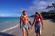 Couple on beach, Lanikai, Kailua, Oahu, Hawaii<br />