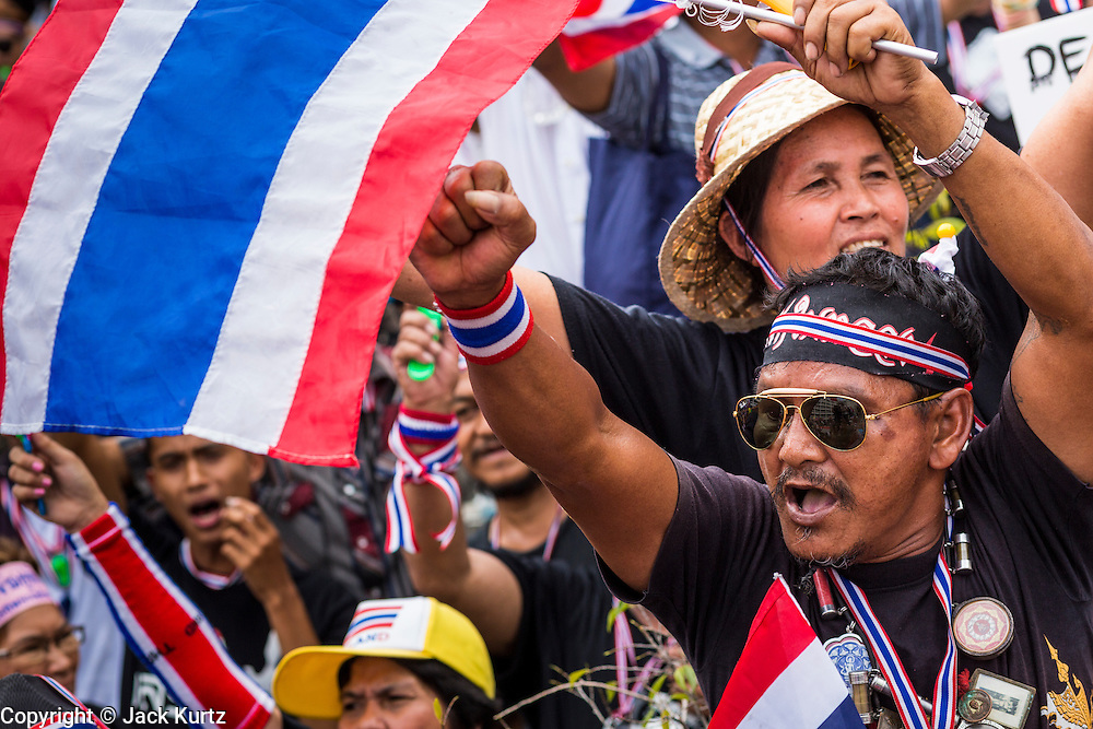 26 NOVEMBER 2013 - BANGKOK, THAILAND: Thai anti-government protestors cheer an opposition speaker during a rally at the Ministry of Finance in Bangkok. Protestors opposed to the government of Thai Prime Minister Yingluck Shinawatra spread out through Bangkok this week. Protestors have taken over the Ministry of Finance, Ministry of Sports and Tourism, Ministry of the Interior and other smaller ministries. The protestors are demanding the Prime Minister resign, the Prime Minister said she will not step down. This is the worst political turmoil in Thailand since 2010 when 90 civilians were killed in an army crackdown against Red Shirt protestors. The Pheu Thai party, supported by the Red Shirts, won the 2011 election and now govern. The protestors demanding the Prime Minister step down are related to the Yellow Shirt protestors that closed airports in Thailand in 2008.     PHOTO BY JACK KURTZ