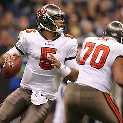 Dec 27, 2009; New Orleans, LA, USA; Tampa Bay Buccaneers quarterback Josh Freeman (5) looks to pass during the second quarter against the New Orleans Saints at the Louisiana Superdome. Mandatory Credit: Derick E. Hingle-US PRESSWIRE..