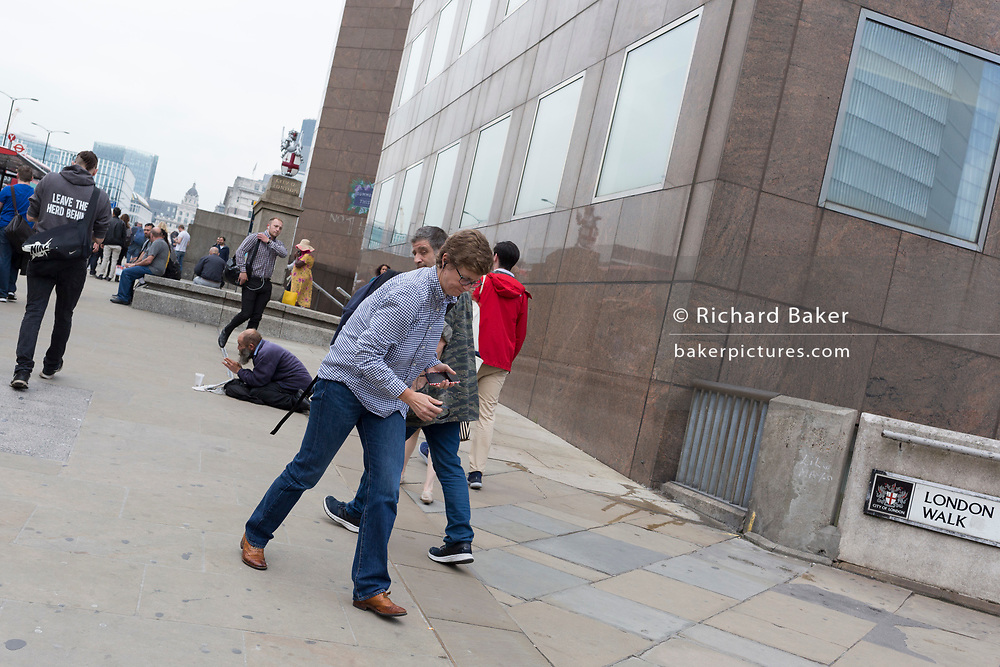 Commuters at the southern Southwark end of London Bridge, on 30th May 2018, in London, England.