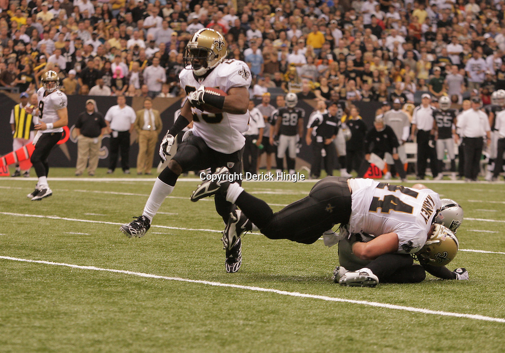 2008 October, 12: New Orleans Saints running back Reggie Bush (25) follows the block of teammate Mike Karney (44) on his way to a three yard touchdown run during a week six regular season game between the Oakland Raiders and the New Orleans Saints at the Louisiana Superdome in New Orleans, LA.