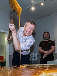 Pictured: Willie Rennie shows what he has learnt under the watchfull eye of master fudge maker Will Tebbutt<br />