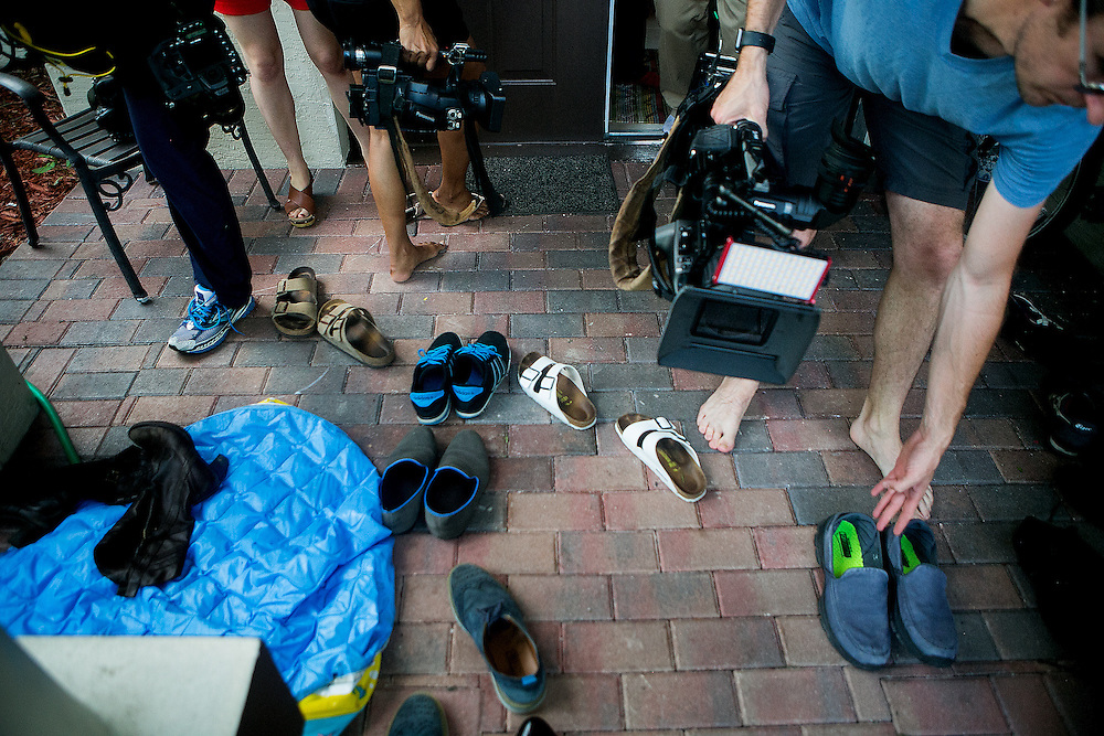 PORT ST LUCIE, FL - JUNE 13, 2016: Reporters put their shoes back on after removing them to enter the home of and interview Seddique Mir Mateen, the father of Omar Mateen, who is reported to have committed a mass shooting that took place inside the Pulse nightclub in Orlando, Florida. CREDIT: Sam Hodgson for The New York Times.